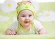 smiling baby girl over flower background