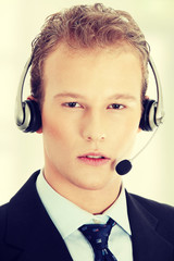 Young man with phone-headset