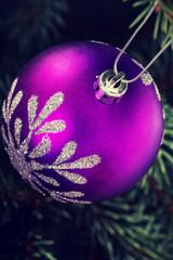 One christmas ball handing on a twig.