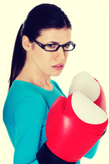 Portrait of a casual woman with boxing gloves.