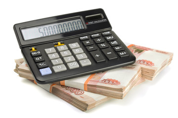 Calculator and stack of money