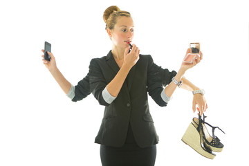 Busy business woman multi-tasking holding objects