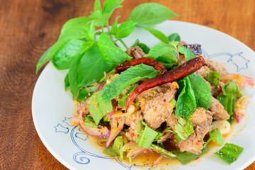Sliced grilled pork salad