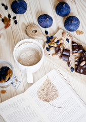 cup of coffee with book and chocolate