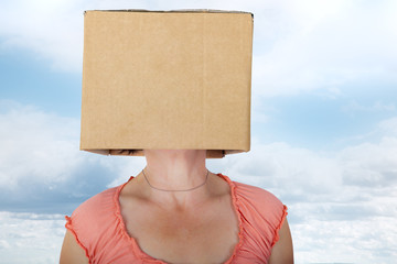 Woman has box with painted face on the head