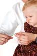 Woman cuts toddler's fingernails