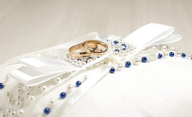Pair of wedding rings on the luxury pillow