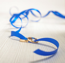 Tigether concept two golden rings in the same ribbon