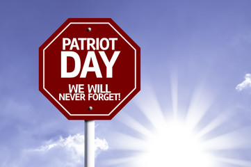 Patriot Day, We Will Never Forget red sign with sun background