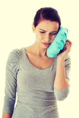 Young casual woman having a toothache.