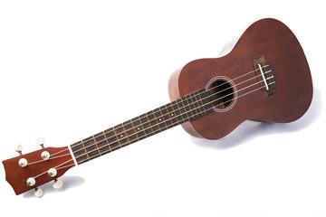 Vintage ukulele on white background