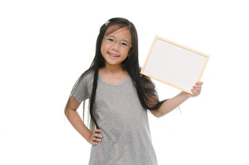 Little Asian girl holding empty whiteboard
