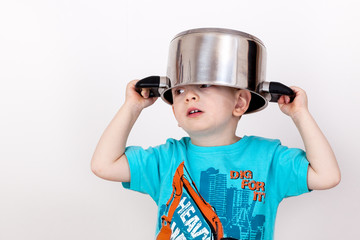 Child holding cooking pot on his head