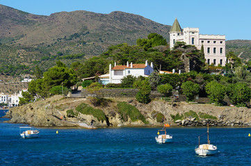 Mediterranean sea shore with boats and house Spain