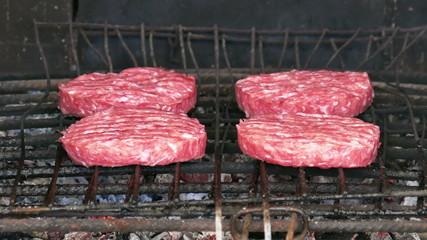 Hamburgers Cutlets Grilling on Grid, closeup