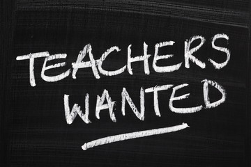 Teachers Wanted written on a just wiped blackboard