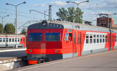 Modern red suburban electric train standing at the station in Ru