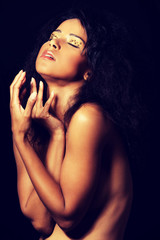 Beautiful mulatto woman with tiger make up.