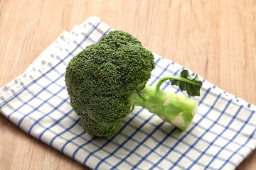 Broccoli on wooden table
