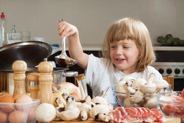 child cooking in kitchen