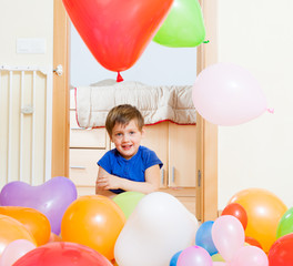 little girl  with balloons .