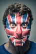Spooky man with British flag painted on face