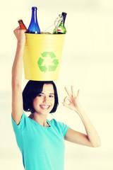 Beautiful woman holding recycling basket