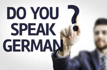 Business man pointing the text: Do you Speak German?
