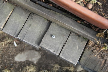 screw in a wooden carriage