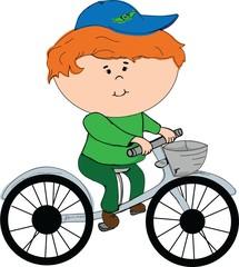 Веселый мальчик на велосипеде