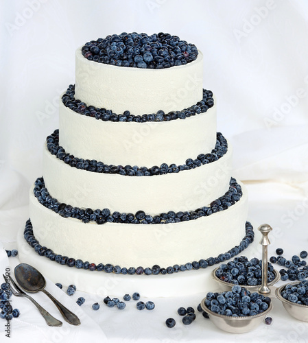 Fototapeta Wedding cake on white background with blueberries