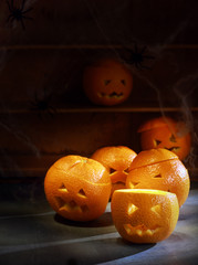 Group of Jack o Lanterns Carved from Oranges