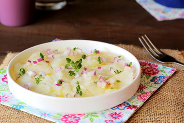 Cod carpaccio with red onions, olive oil and herbs
