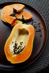 Papaya on a wooden tray