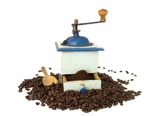 Front view of an old coffee grinder with beans