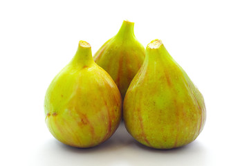Three figs isolated on white background