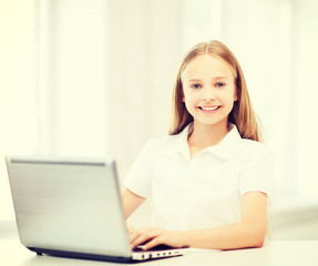 girl with laptop pc at school