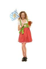Mädchen im Dirndl mit Bier und Bayernfahne