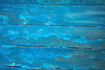 blue wooden planks with peeling paint, texture