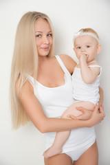 mother with her baby studio shot