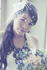 Beauty bride holding bouquet.