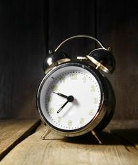 Alarm clock . On wooden background.