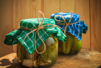 Pickled cucumbers jars wooden table