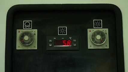View of temperature indicator on panel