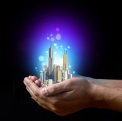 Мetropolis in businessman's hand