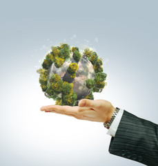 Eco planet in businessman's hand