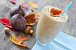 Leinwandbild Motiv Healthy exotic smoothie variation with figs and nuts