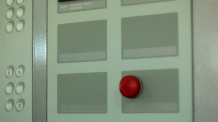 Red button and indicator on control panel