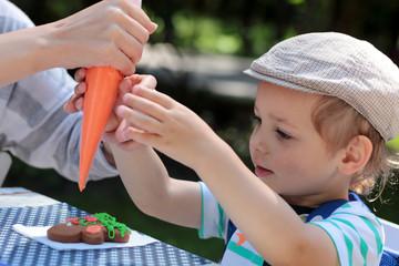 Boy coloring gingerbread