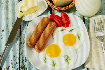 fried eggs with sausage breakfast